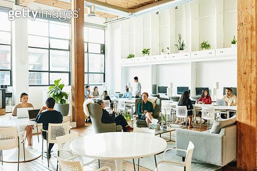 Interior view of businesspeople working in coworking office - gettyimageskorea