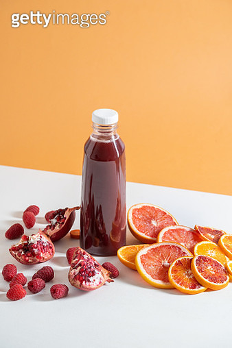 Still life of red smoothie and fruit - gettyimageskorea