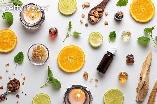 Bottles Of Essential Oil With Fresh Citrus Fruit - gettyimageskorea