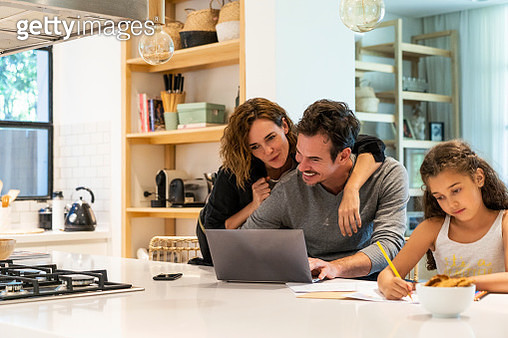 Couple using laptop while daughter studying - gettyimageskorea