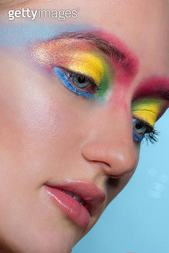 Close-Up Of Woman With Colorful Eye Make-Up - gettyimageskorea