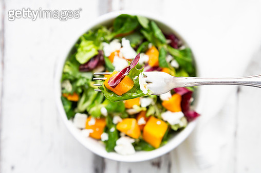 Fork of autumnal salad with feta and Hokkaido pumpkin - gettyimageskorea