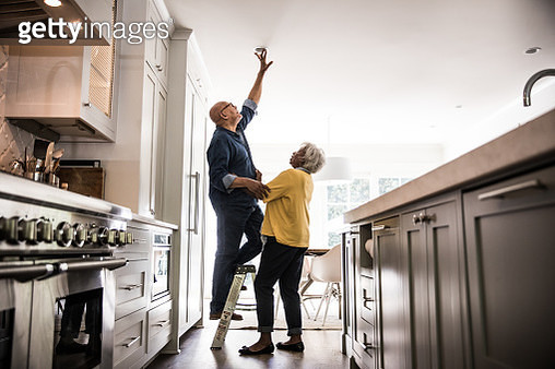 Senior couple couple doing DIY project at home - gettyimageskorea