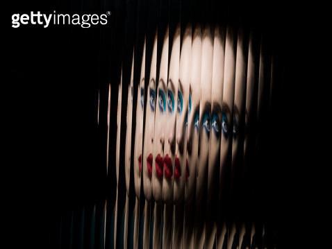 Portrait of female through glass - gettyimageskorea
