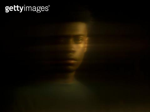 Distorted portrait of dark skinned male,reflection - gettyimageskorea