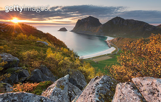 Spectacular view during sunset down to Haukland beach from a mountain, surrounded by bright Autumn colors - gettyimageskorea