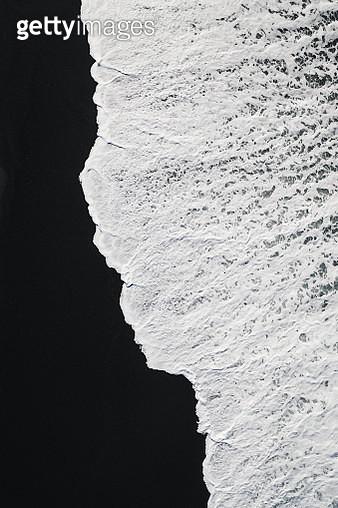 Minimal aerial shot of wave washing onto volcanic black sand beach, Lanzarote - gettyimageskorea