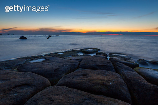 Mystic Flat Rock Laying In The Sea Nightscape After Sunset - gettyimageskorea