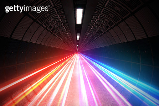 Futuristic picture of colorful light trails moving fast in subway tunnel. - gettyimageskorea