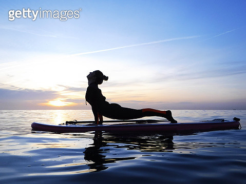 Girl practicing yoga on SUP (Stand Up Paddleboarding) in the Mediterranean Sea - gettyimageskorea