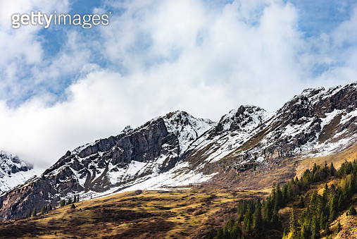 Scenic View Of Snowcapped Mountains Against Blue Sky - gettyimageskorea