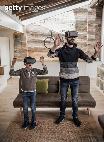 Father and son with virtual glasses in loft - gettyimageskorea