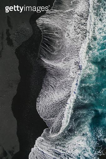 Ocean waves crashing onto volcanic sands as seen from above, Lanzarote - gettyimageskorea