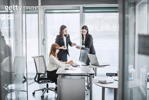 Three young businesswomen working in the office - gettyimageskorea