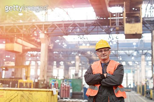 Portrait confident steel worker in factory - gettyimageskorea