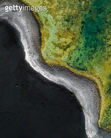 Contrast between volcanic sand and vibrant salt lake as seen from above, Lanzarote - gettyimageskorea