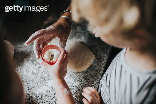 Process of baking scones with children helping. - gettyimageskorea