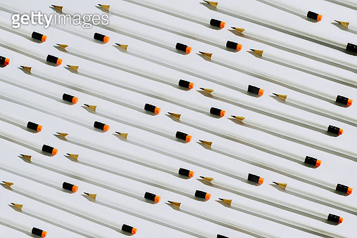 Row of white pencils lying on a white background - gettyimageskorea