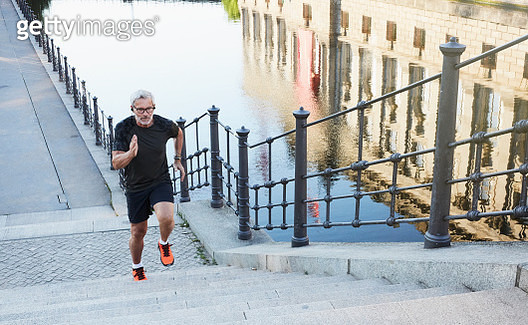 portrait of an active senior man doing exercise in the city of Berlin - gettyimageskorea