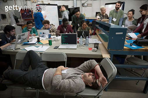 Exhausted hacker resting working hackathon in workshop - gettyimageskorea