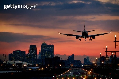 Landing airplane at dusk - gettyimageskorea