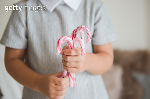 Hands of girl holding christmas candies - gettyimageskorea