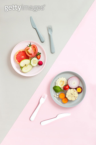 Minimalist style healthy eating colourful sliced vegan food served on coloured eating utensil in coloured background. - gettyimageskorea