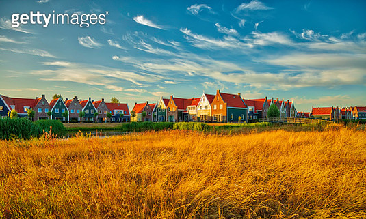 A traditional Dutch village with colorful, old wooden houses, brigdes and canals - gettyimageskorea
