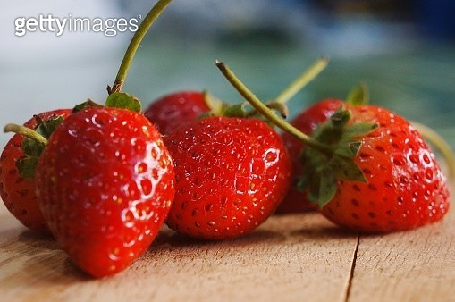 Close-Up Of Strawberries On Table - gettyimageskorea