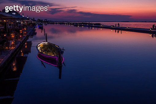 Boats Moored On Sea Against Sky During Sunset - gettyimageskorea