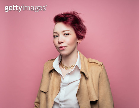 Woman on pink background wearing leather jacket - gettyimageskorea