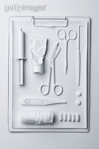 Medicine and medical equipment painted white and laid out on a clipboard - gettyimageskorea