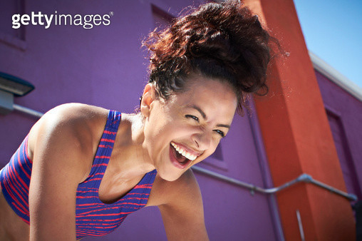 Young fit woman laughing - gettyimageskorea