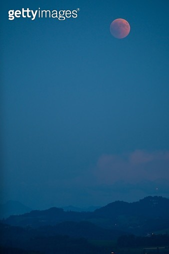Scenic View Of Mountains Against Blue Sky At Night - gettyimageskorea