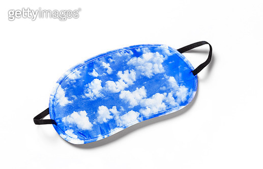 dreamlike blue sky and clouds on sleep mask to encourage rest and sleep - gettyimageskorea