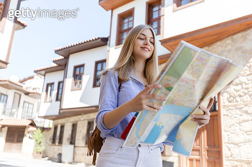 Beautifu tourist girl with map in old city - gettyimageskorea