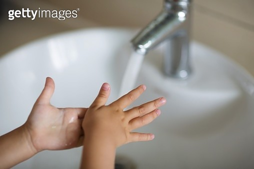 Cropped Image Of Girl Washing Hands By Bathroom Sink - gettyimageskorea