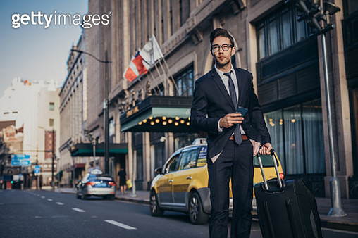 Businessman leaving city - gettyimageskorea
