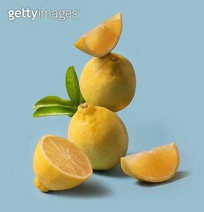 Lemon fruit still life on light blue background. Close up view. - gettyimageskorea