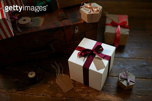 Christmas present with ribbon in rustic room. - gettyimageskorea