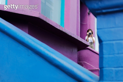 Young tourist woman standing on the color walls - gettyimageskorea