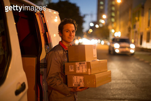 Courier delivering parcels and boxes - gettyimageskorea