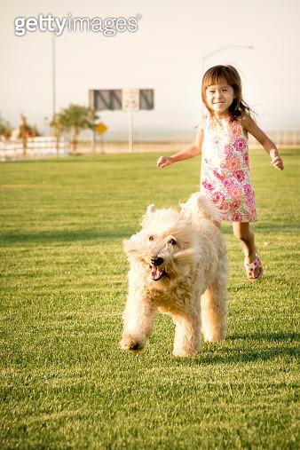 Little Girl running After Dog - gettyimageskorea