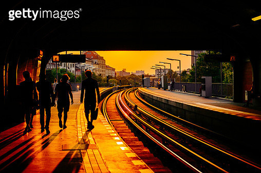 Silhouette people walking at railroad station - gettyimageskorea