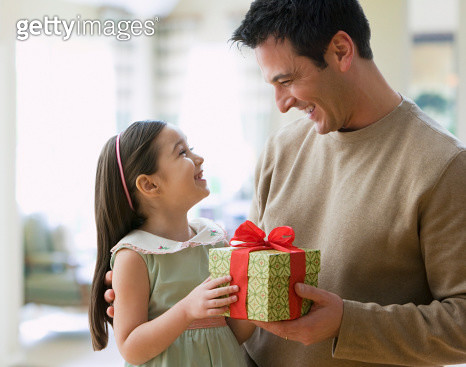 Girl (4-5) giving gift to father - gettyimageskorea