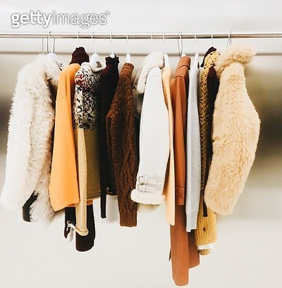 Clothes Hanging On Rack - gettyimageskorea