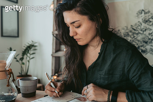 Woman making notes in diary - gettyimageskorea