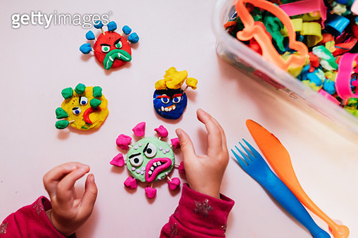 Child playing with plasticine at home making virus - gettyimageskorea