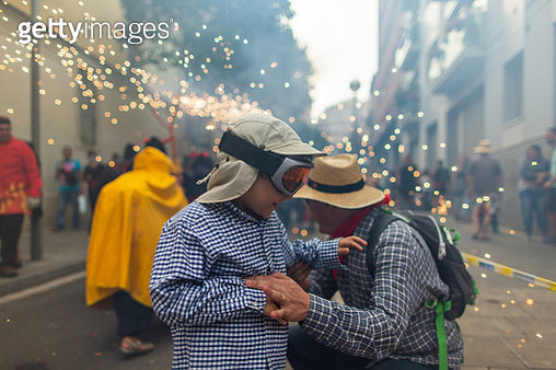 Father and toddler son at Correfoc celebration - gettyimageskorea