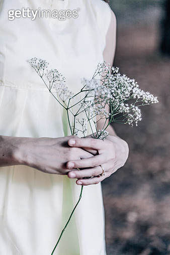 Midsection Of Bride Holding Flowers - gettyimageskorea